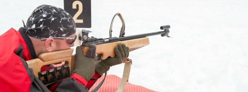 An athlete takes aim during biathlon practice at Whistler Olympic Park
